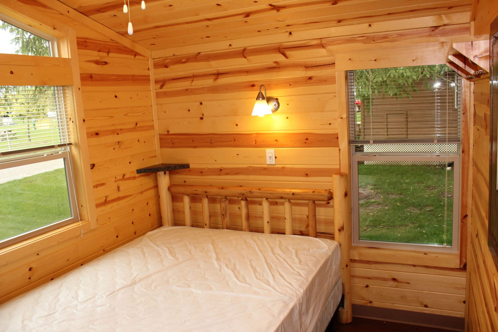 regular bed in cabin bedroom